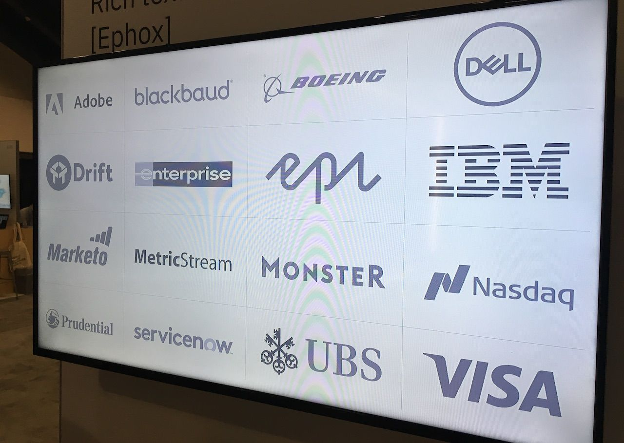 Presentation with logowall of TinyMCE clients including Adobe, Dell, IBM, UBS, and Visa.